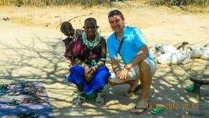 Liam in a Masai village