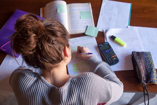 Student studying, A-Level revision papers