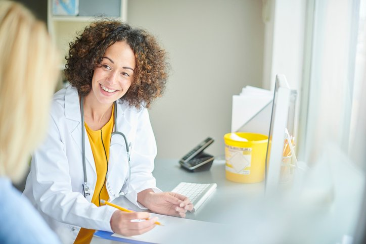 Female doctor speaks to patient